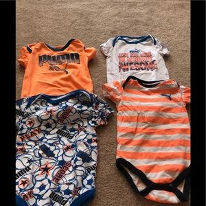 Four pack of Boy's onesies.